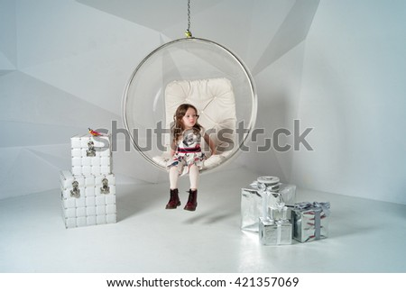 girl in the glass hemisphere with gifts - stock photo