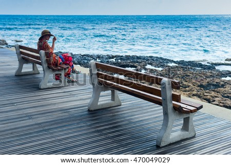 girl in the hat on the benches by the sea,