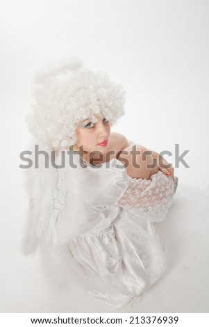 girl in the image of an angel with a funny haircut - stock photo