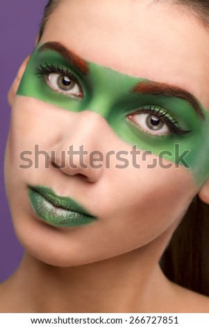 girl in the image of lime fruit. with make-up on her face and the background - stock photo