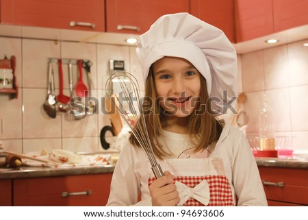 Girl in the kitchen - stock photo