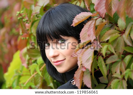 girl in the leaves of wild grapes. portrait