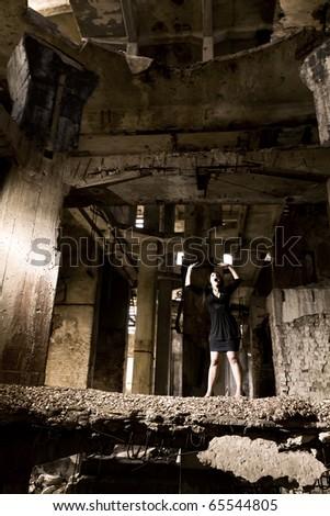 girl in the lone concrete jungle - stock photo