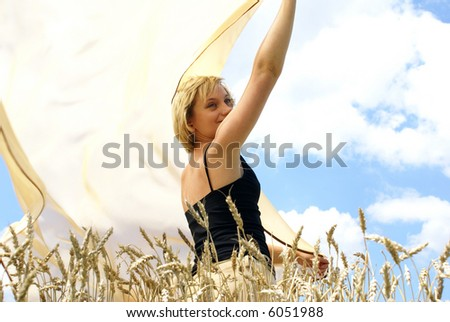 Girl in the middle of a wheaten field