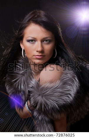 Girl in the nightclub and light in blue tones - stock photo