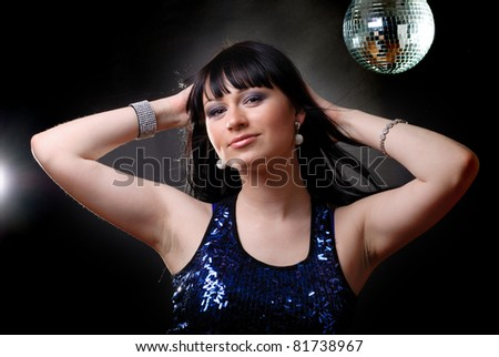Girl in the nightclub is dancing in lights - stock photo