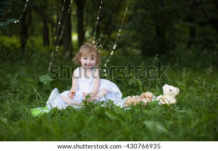 girl in the park,wearing crown,  selective focus - stock photo