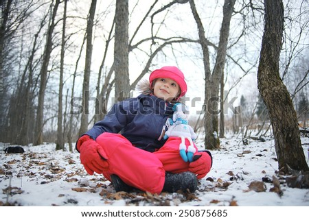 Girl in the park winter snow walk - stock photo
