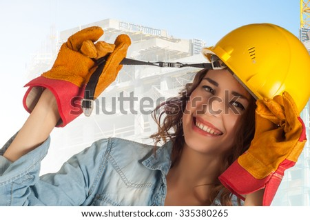 girl in the photo studio. Advertising construction outfit. Special clothing for construction workers, construction workers - stock photo
