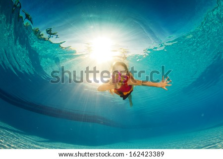 girl in the pool with flowers - stock photo