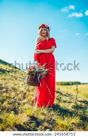Girl in the Red Dress Walking on the Field