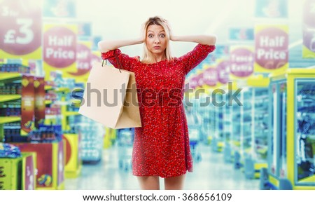 Girl in the supermarket. Shopping. - stock photo