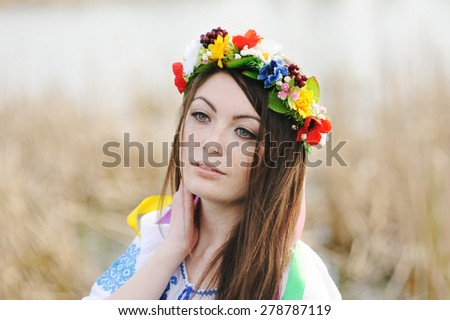 girl in the Ukrainian national shirt and floral wreath on her head - stock photo