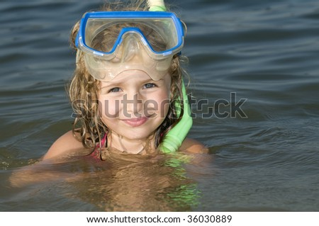 Girl in the water with snorkel - stock photo