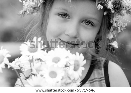 girl in the wreath with a bouquet of daisies - stock photo