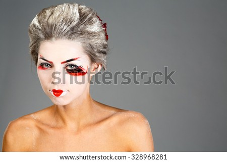 girl in traditional Japanese makeup close up studio shot - stock photo