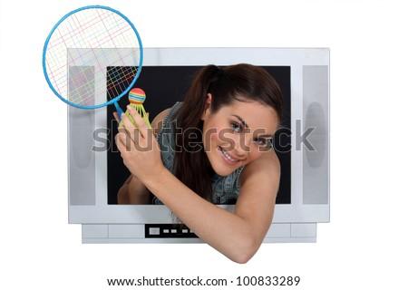 girl in TV screen with badminton racket - stock photo