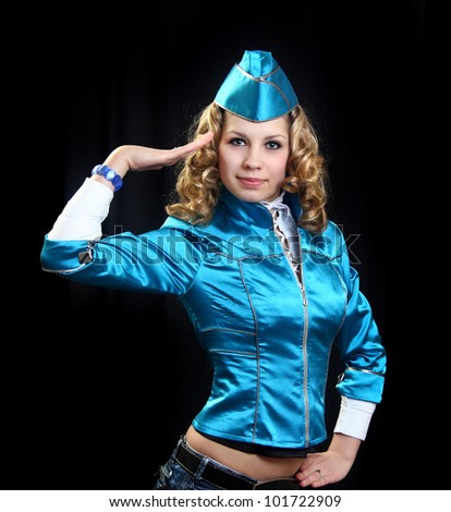 girl in  uniform. On  black background - stock photo
