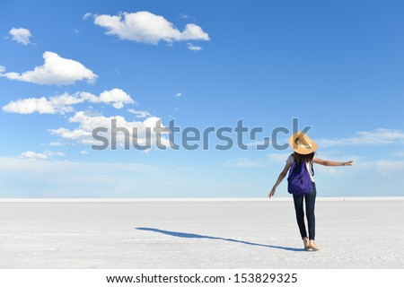 Girl in vacation with vast white salt flats background in Bonneville, Utah - stock photo