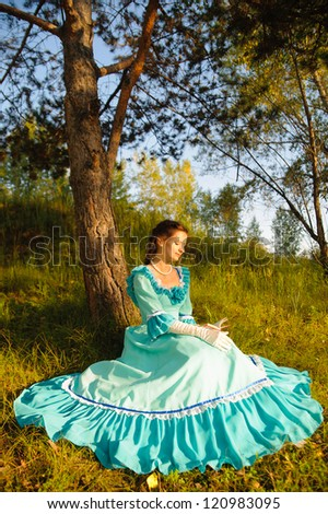 Girl in vintage dress - stock photo