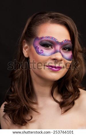Girl in violet mask - stock photo