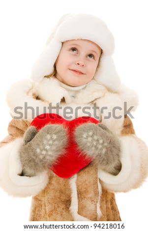 Girl in warm clothing holding the heart in his hands on a white background.