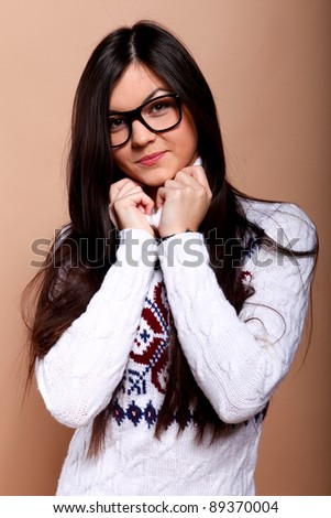 Girl in warm winter sweater and in nerd glasses - stock photo