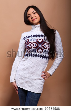 Girl in warm winter sweater with happy smile - stock photo