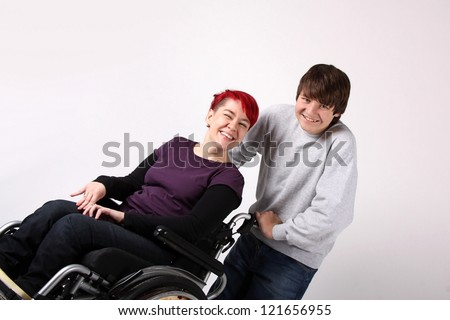 Girl in wheelchair with Helper - stock photo