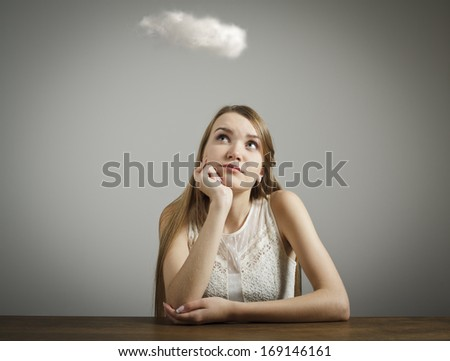 Girl in white and cloud. Imagination concept. - stock photo