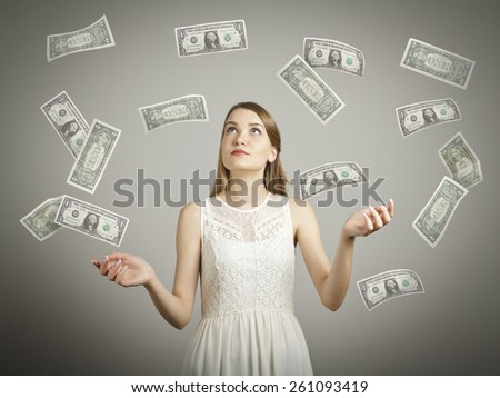 Girl in white and falling dollar banknotes. Currency and lottery concept. - stock photo