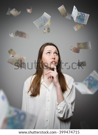 Girl in white and falling euro banknotes. Currency and lottery concept.