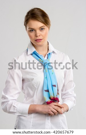 Girl in white blouse with beautiful scarf