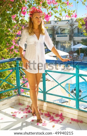 Girl in white dress looks into the distance - stock photo