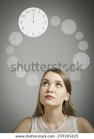 Girl in white is full of doubts and hesitation. Time concept. - stock photo