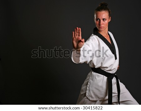 girl in white kimono ready to fight with clipping path - stock photo