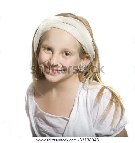 Girl in white with blue eyes smiling - stock photo