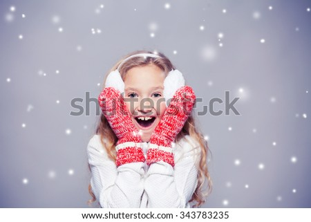Girl in winter clothes. Happy child. Studio shot - stock photo