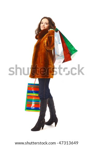 girl in winter clothes with shopping bags, isolated on white - stock photo