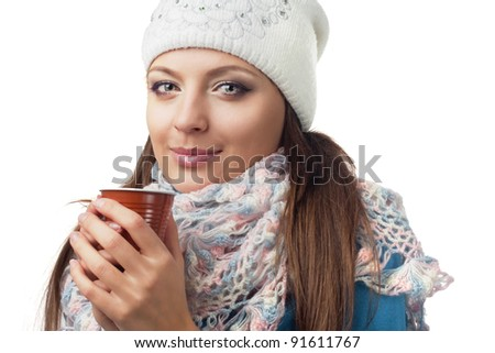 Girl in winter clothing holding a glass, European, White, Caucasian - stock photo