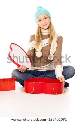 girl in winter hat sitting with gift boxes isolated - stock photo