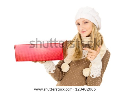 girl in winter hat with a gift - stock photo