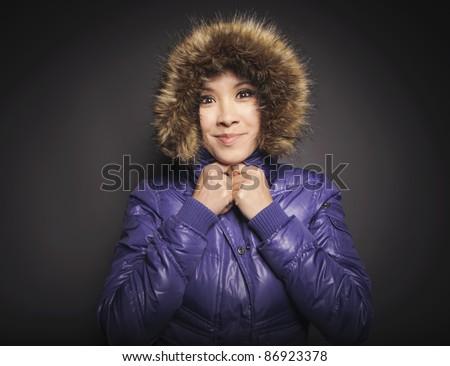 Girl in winter jacket - stock photo