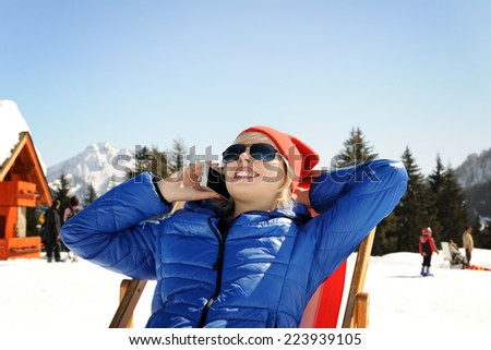 girl in winter mountains - stock photo