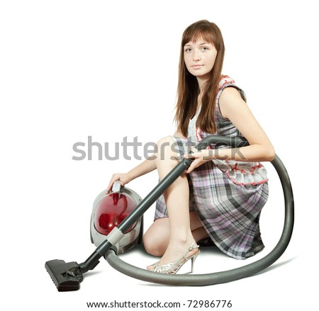 Girl in with vacuum cleaner. Isolated over white background - stock photo