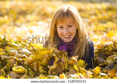 Girl in yellow leaves