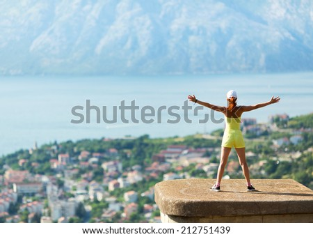 Girl infront of sea - stock photo