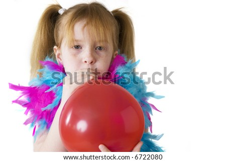 girl is blowing a red balloon - stock photo