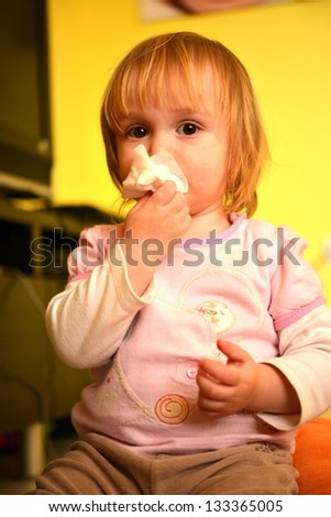 girl is blowing her nose - stock photo
