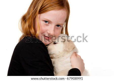 Girl is cuddling with a golden retriever puppy isolated on white